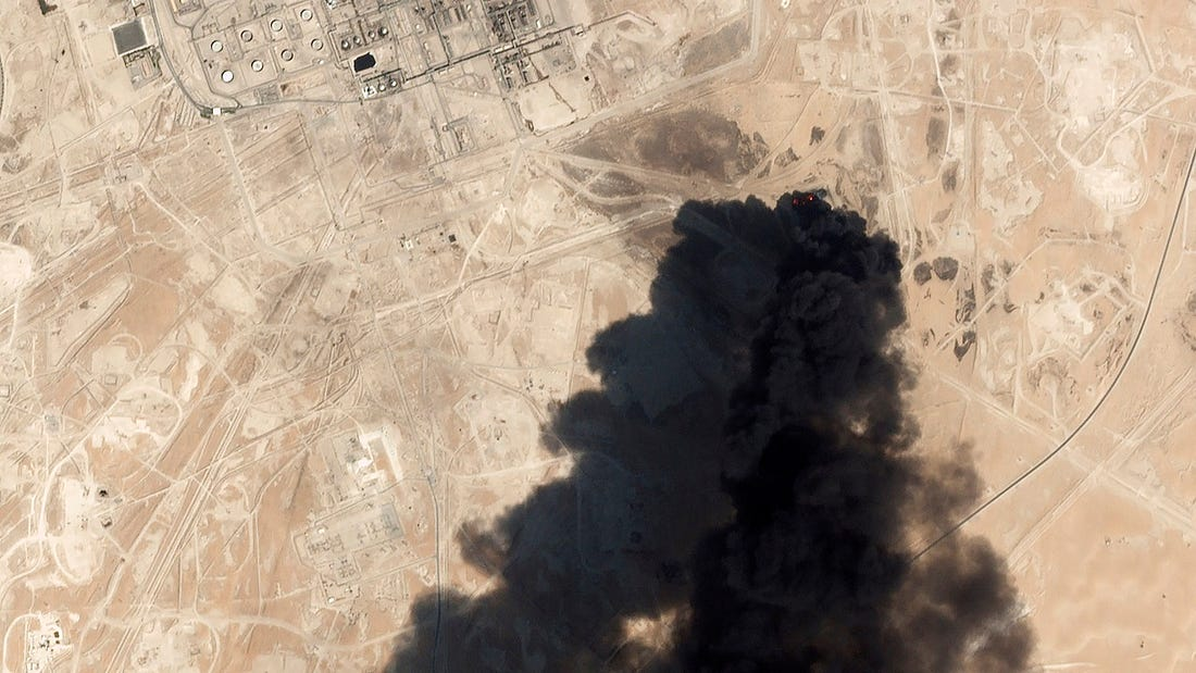 This Saturday, Sept. 14, 2019, satellite image from Planet Labs Inc. shows thick black smoke rising from Saudi Aramco's Abqaiq oil processing facility in Buqyaq, Saudi Arabia. Yemen's Houthi rebels launched drone attacks on the world's largest oil processing facility in Saudi Arabia and a major oil field Saturday, sparking huge fires and halting about half of the supplies from the world's largest exporter of oil. (Planet Labs Inc via AP)