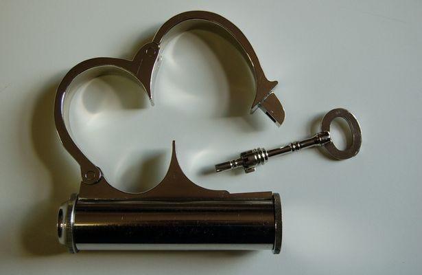 The-replica-silver-handcuffs.jpg
