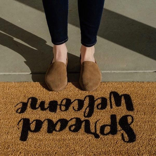 Spread Welcome Mat