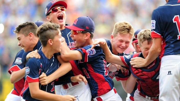 The winning team celebrates at the Little League World Series.