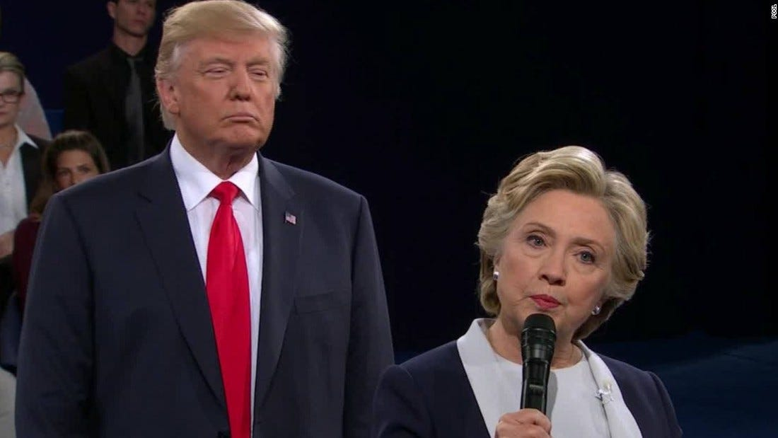 Image result for Trump standing behind Clinton