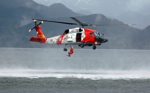 SITKA, Alaska - A Coast Guard HH-60 performs a search and rescue, (SAR), demonstration following the annual Alaska Day Parade on October 18, 2007. The rescue swimmer is deployed to recover a person simulating distress in the water, displaying rescue techniques that would be used in an actual SAR case. (Official Coast Guard photo by Petty Officer Eric J. Chandler)
