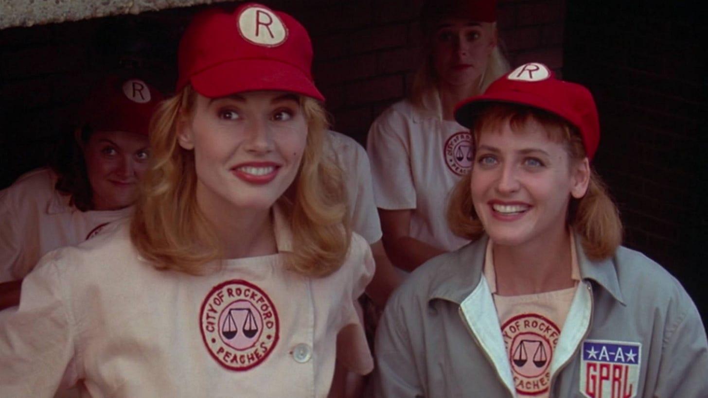 Geena Davis and Lori Petty as Rockford Peach baseball players in A League Of Their Own