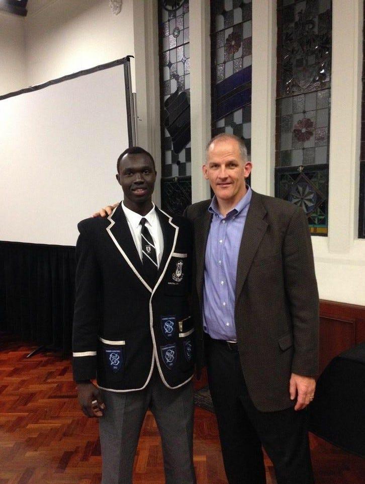 Chiir Maker with University of Portland Head Coach, Eric Reveno