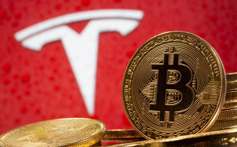 Bitcoin tops $40,000 after Musk says Tesla could use it again   Reuters