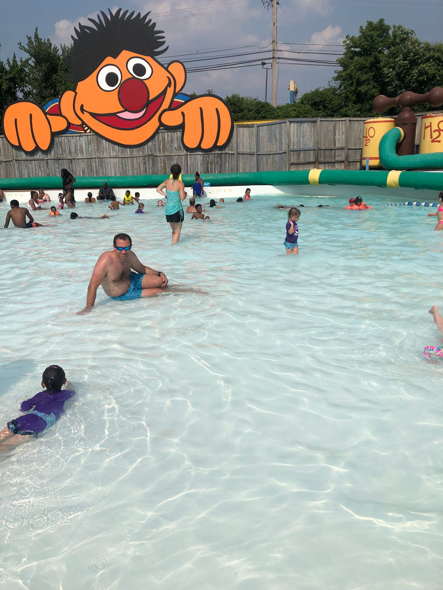 Photograph shows a wave pool with toddlers in it.