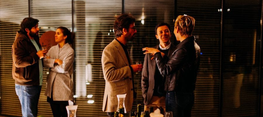 People talking at networking cocktail party