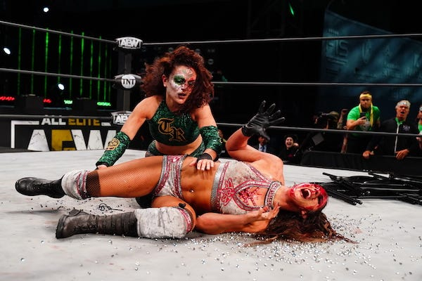 Thunder Rosa attempts to pin a bloody Britt Baker, who has just been planted onto thumbtacks
