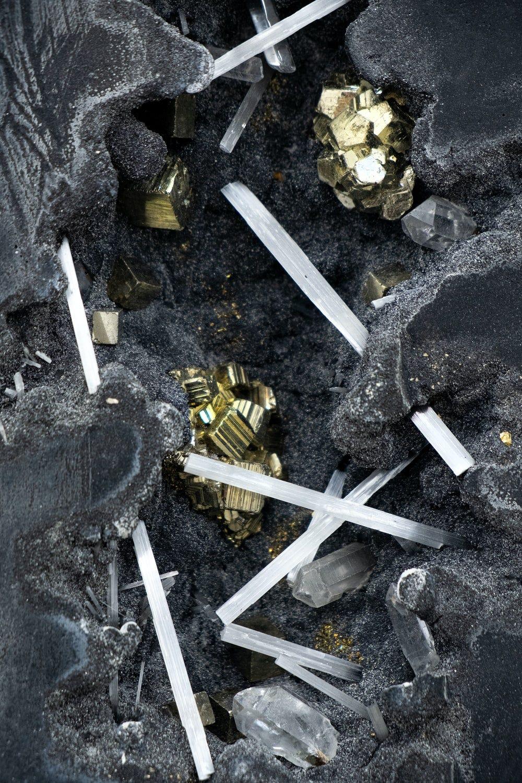 white cigarette stick on black textile