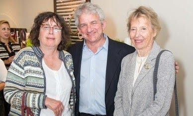 A photo of three older white people, with Georgia Schuttish on the left-hand side