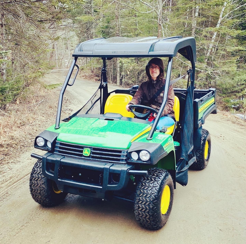 me driving a John Deere gator atv
