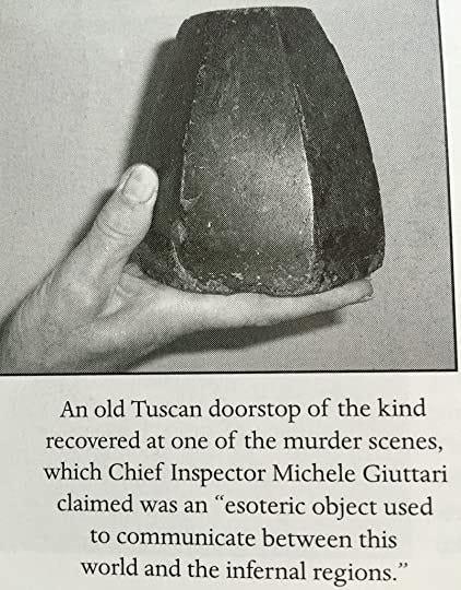 A palm sized, hexagonal-shaped rock-like doorstop