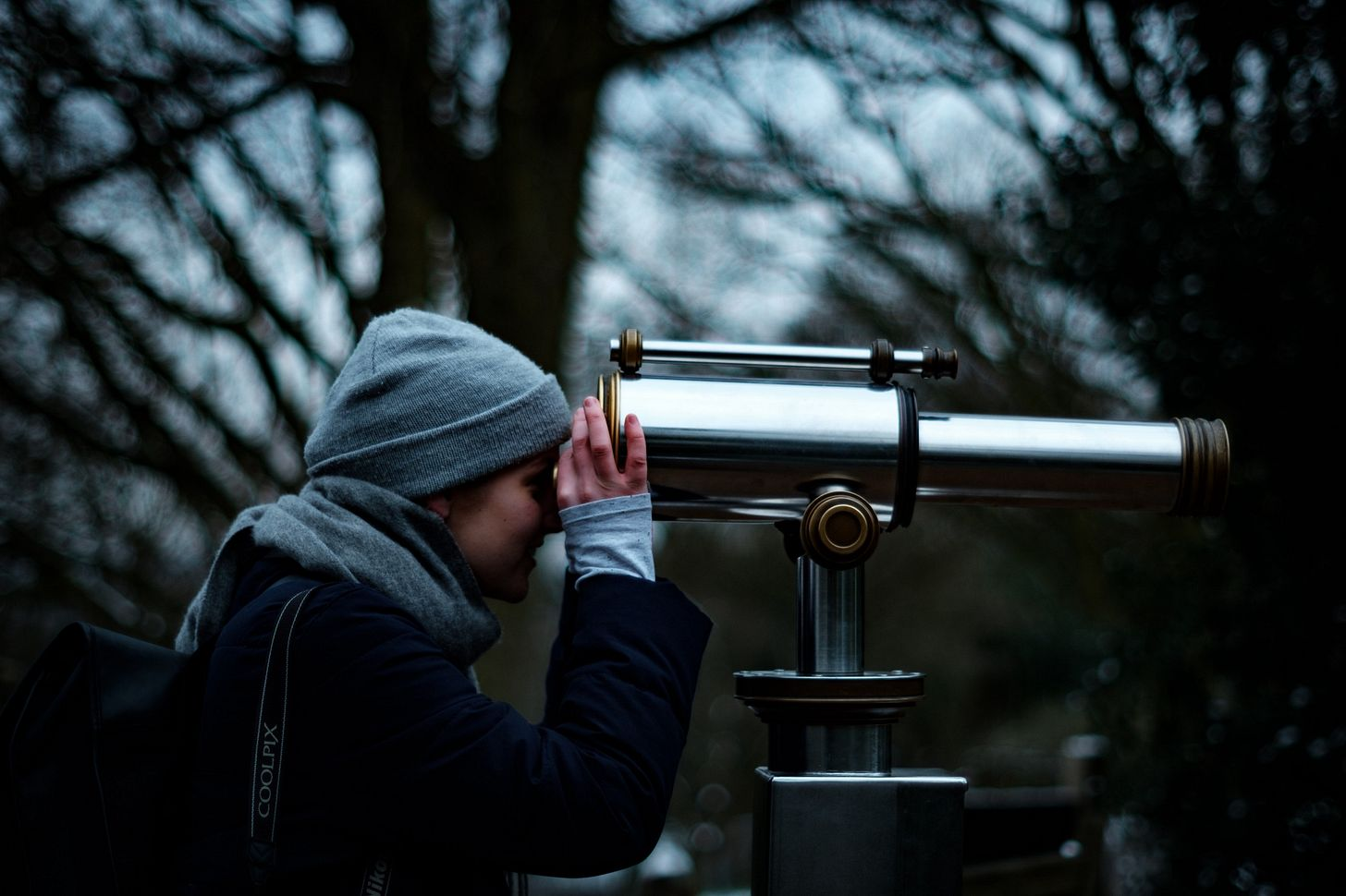 image of a girl looking through a telescope for an article on focus by Larry G. Maguire