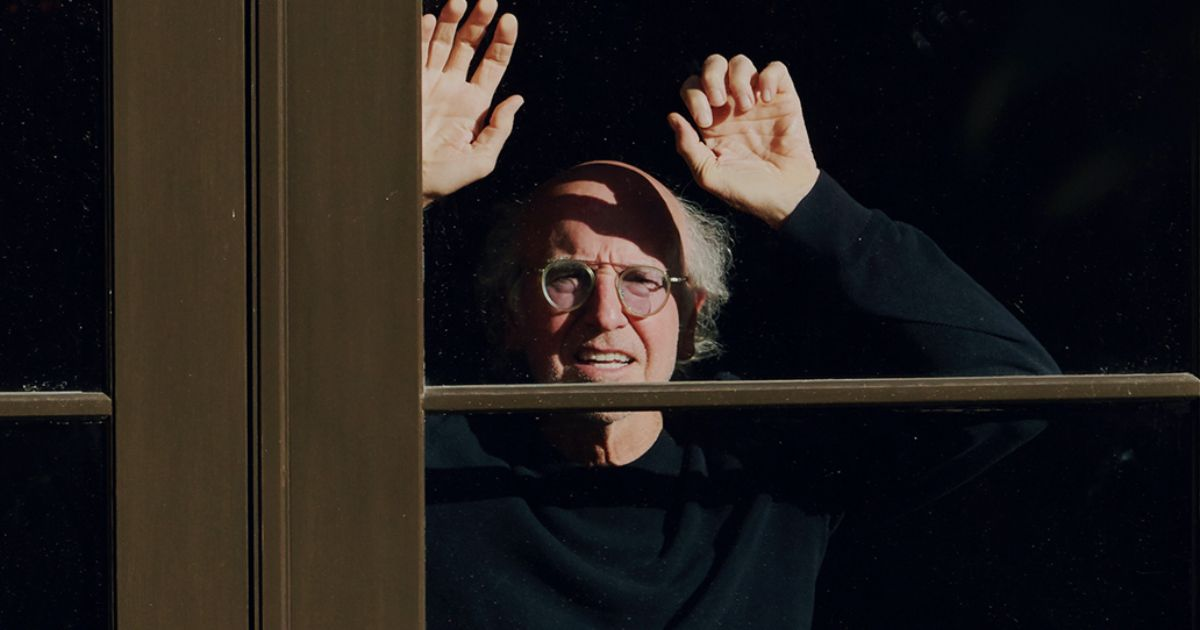 Larry David staring through window