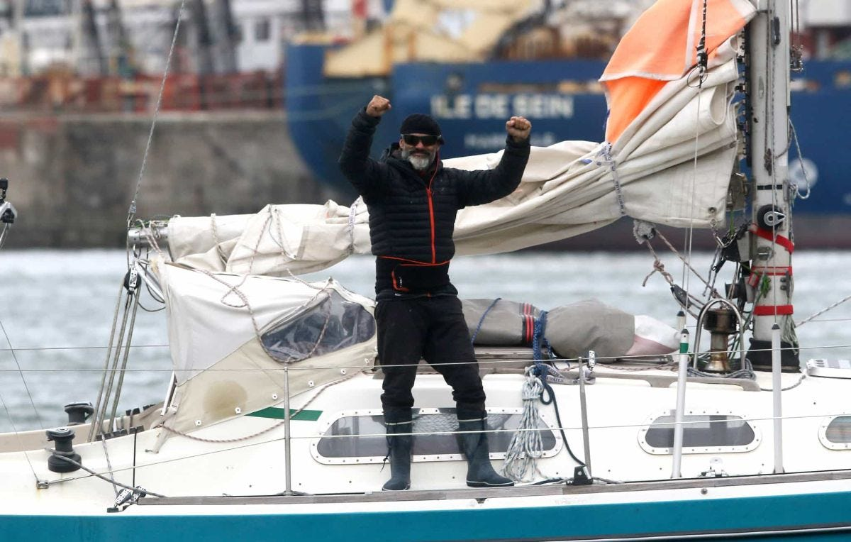 juan manuel ballestero stands on his boat after sailing across the atlantic ocean to see his father