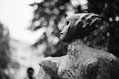 May be a black-and-white image of sculpture, outdoors and monument