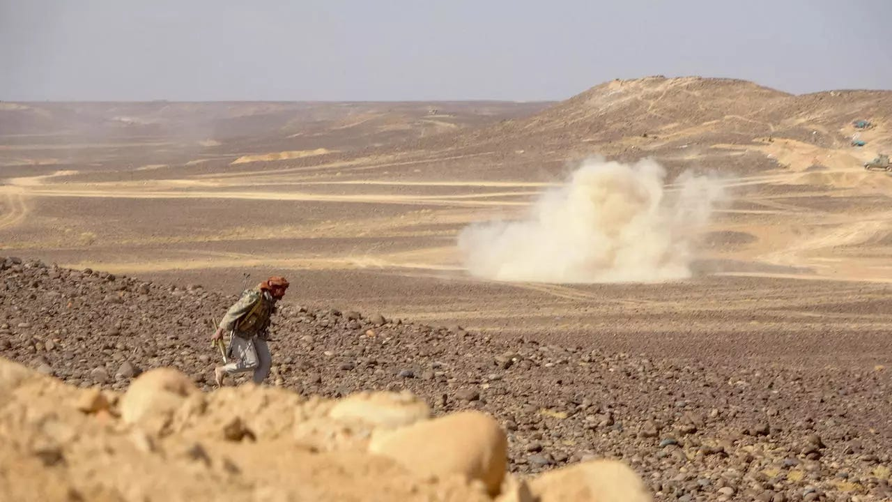 Smoke billows during clashes between forces loyal to Yemen's Saudi-backed government and Houthi rebel fighters in al-Jadaan area 50 kilometres northwest of Marib in central Yemen on February 11, 2021.