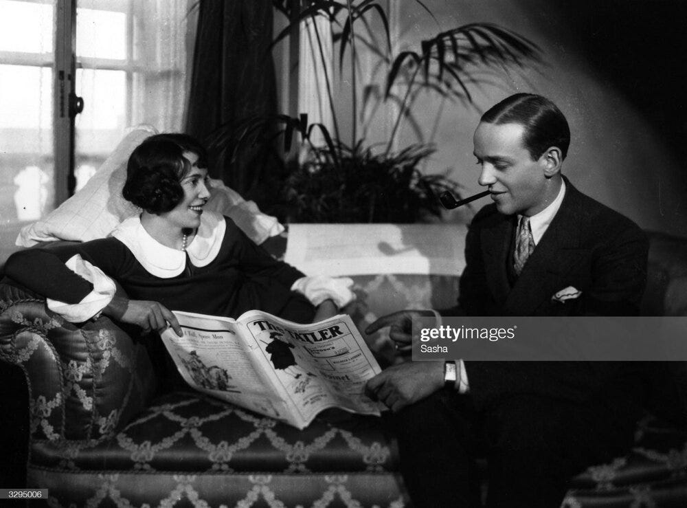 1926 photograph of Fred Astaire and his sister Adele reading 'The Tatler' a British lifestyle magazine. Unidentifiable large rectangular wristwatch. (Photo by Sasha/Hulton) Image credit:  Getty Images