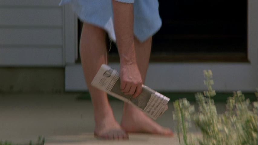 Still from Goodfellas ending of Henry Hill picking up newspaper
