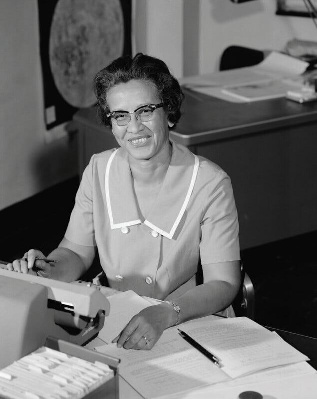photo of Katherine Johnson in 1966 at her desk at NASA