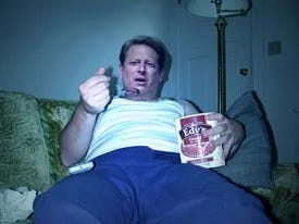 Al Gore looking sad and eating ice cream