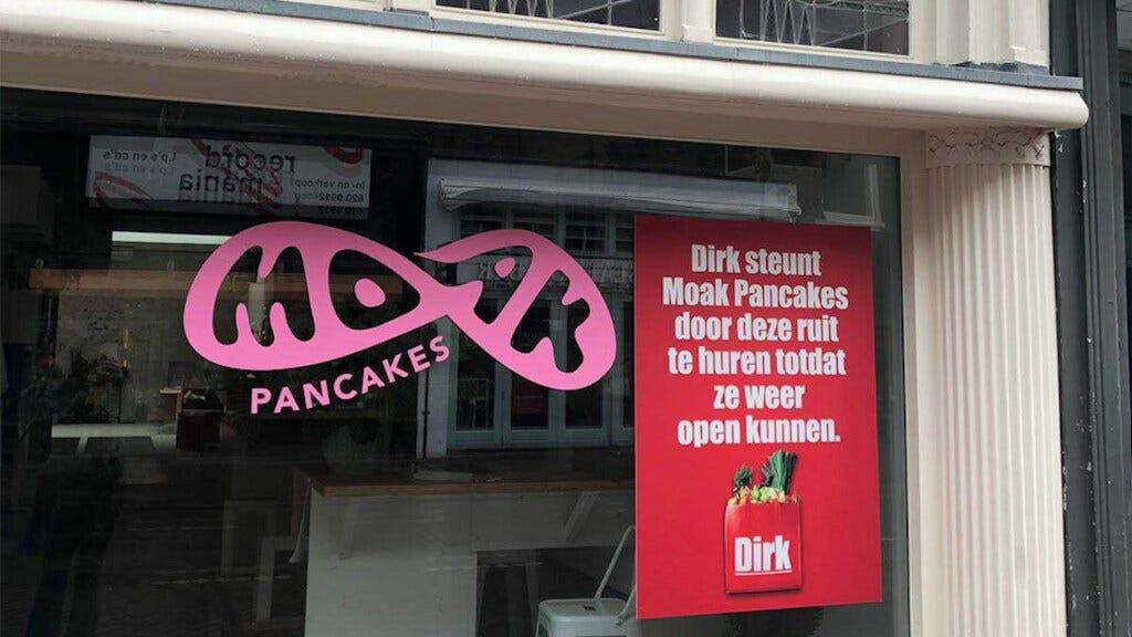Moat Pancakes and Dirk van den Broek billboard on closed store