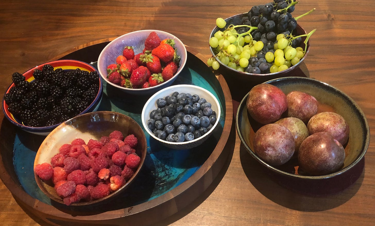 Blackberries, strawberries, raspberries, blueberries, plums, and two kinds of grapes, all from a single farmer's market in early September, 2021