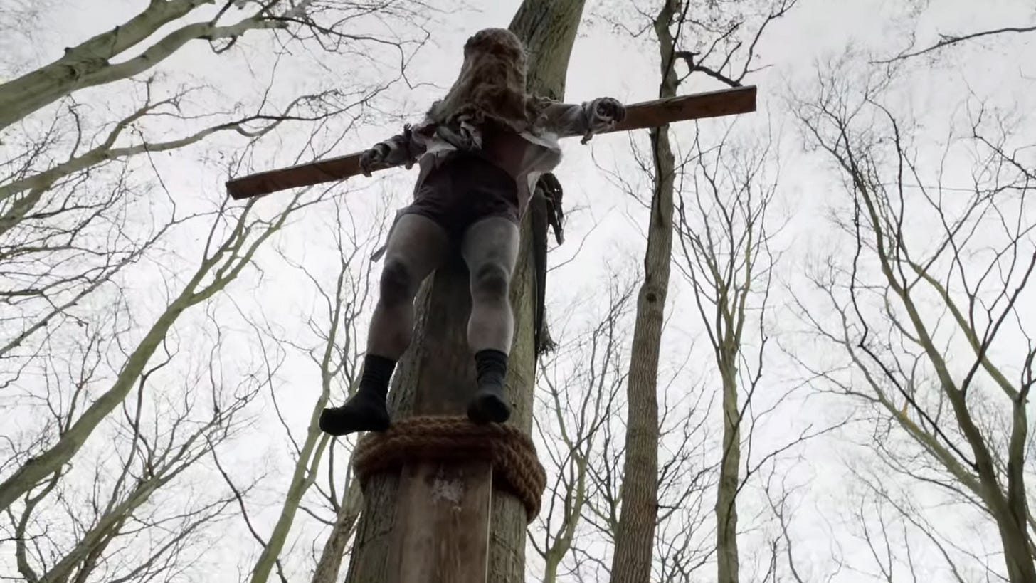 man hung on a tree crucifixion style