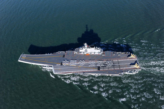 """Chinese sailors on China's first aircraft carrier, the Liaoning, stand in formation forming characters reading """"China Dream, Strong Army Dream."""""""