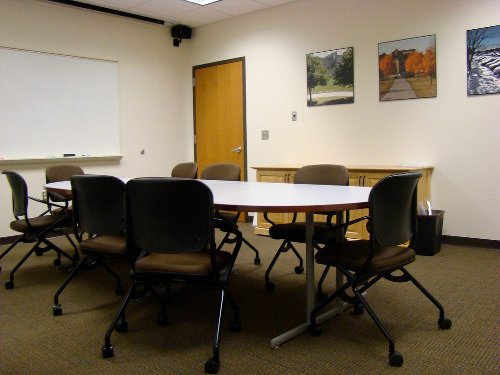 Meeting table in conference room and whiteboard