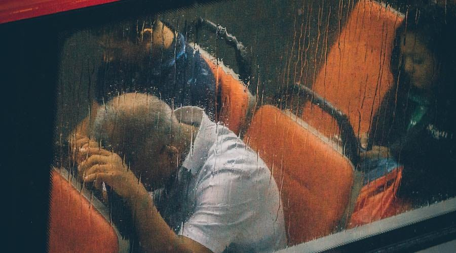 Sad tired man on bus