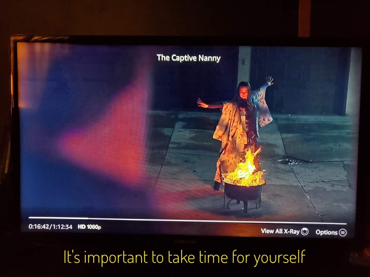 """Chloe watching Emily dancing around a small fire bowl on a cracked concrete patio, captioned """"It's important to take time for yourself"""""""