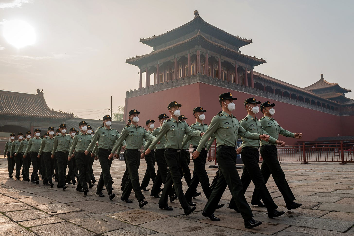 eople's Liberation Army (PLA) soldiers march next to the entrance to the Forbidden City during the opening ceremony of the Chinese People's Political Consultative Conference (CPPCC) in Beijing on May 21, 2020. - China's biggest political event of the year, the National People's Congress (NPC), opens on May 22 after months of delay over coronavirus fears, with President Xi Jinping determined to project strength and control over the outbreak despite international criticism and a wounded economy. (Photo by NICOLAS ASFOURI / AFP) (Photo by NICOLAS ASFOURI/AFP via Getty Images)