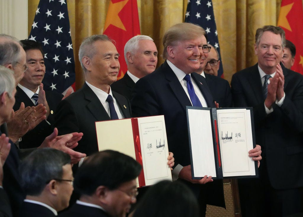 resident Donald Trump and Chinese Vice PremierLiuHe, hold up signed agreements of phase 1 of a trade deal between the U.S. and China, in the East Room at the White House, on January 15, 2020 in Washington, DC. Phase 1 is expected to cut tariffs and promote Chinese purchases of U.S. farm,and manufactured goods while addressing disputes over intellectual property. (Photo by Mark Wilson/Getty Images)