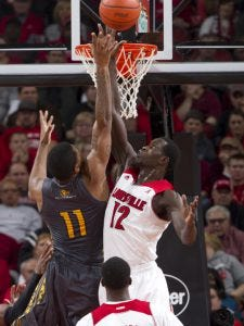 Mangok Mathiang with the block against Southern Mississippi - Courtesy University of Louisville