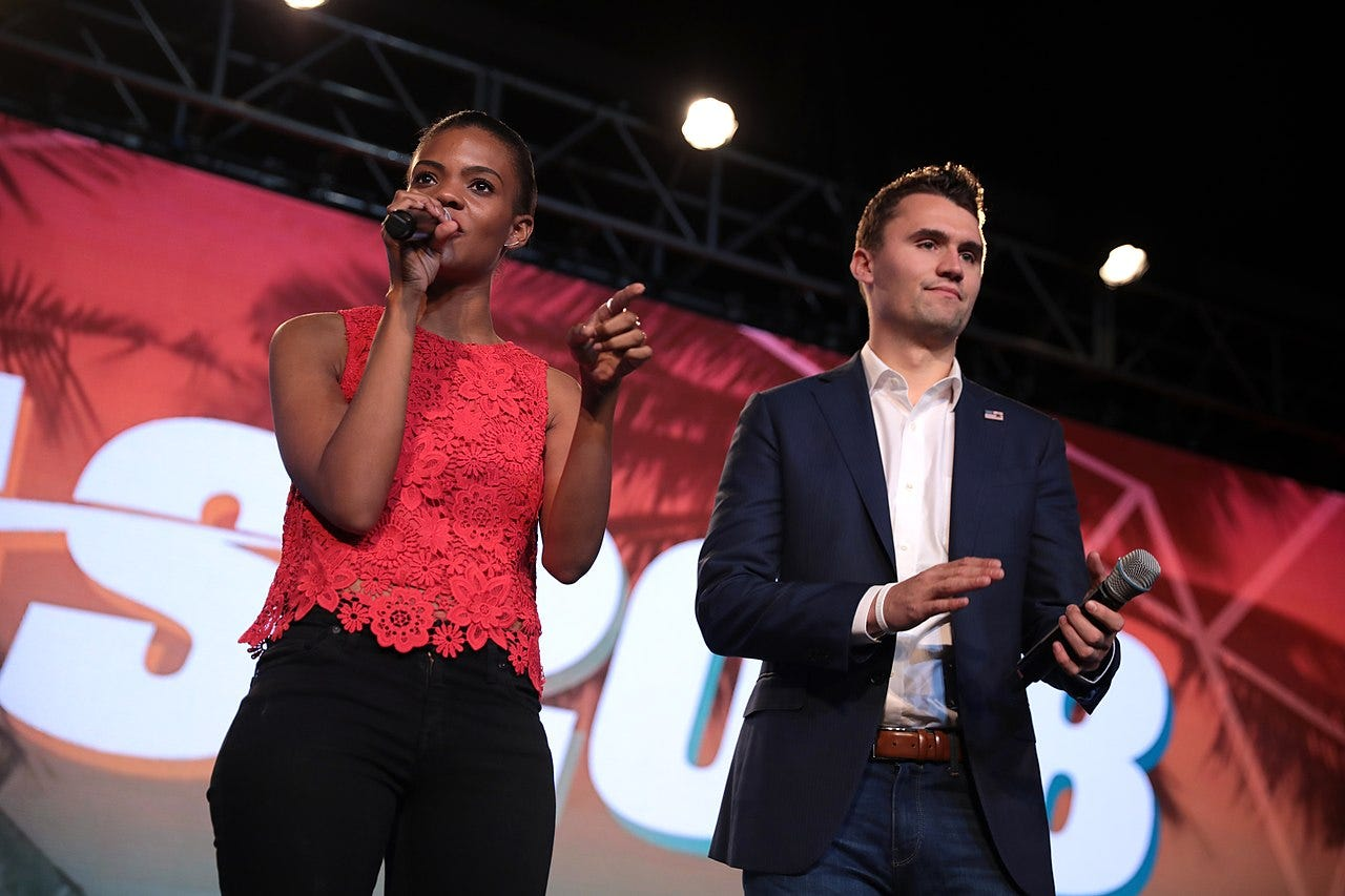 Candace Owens and Charlie Kirk speaking with attendees at the 2018 Student Action Summit hosted by Turning Point USA at the Palm Beach County Convention Center in West Palm Beach, Florida