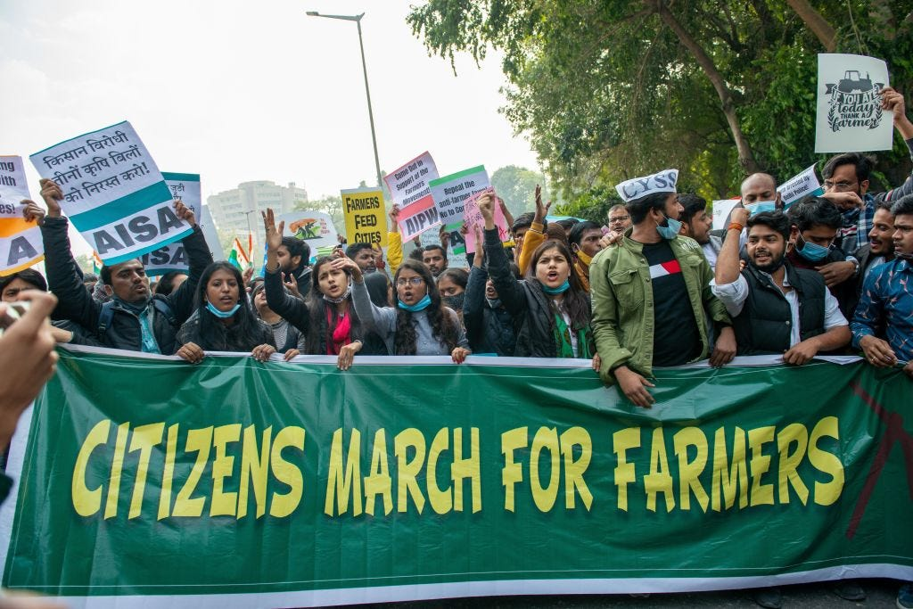 People in India protesting attacks on farmers and a partial internet ban. The protests are at the heart of a conflict between India and Twitter. (Pradeep Gaur / Getty Images)