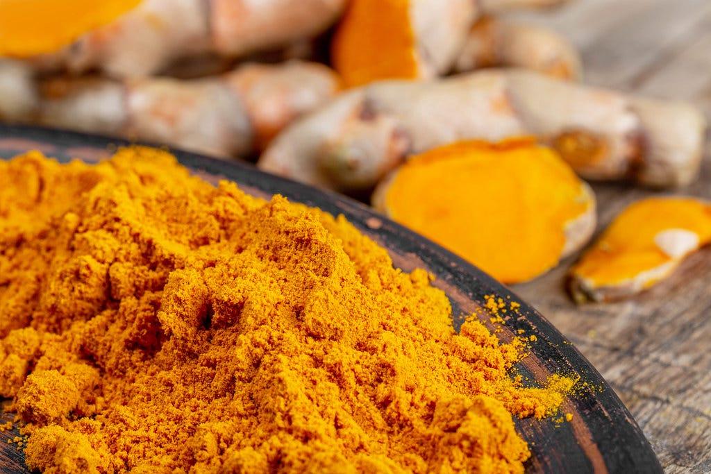 Orange turmeric powder with fresh turmeric | 💾 Marco Verch … | Flickr