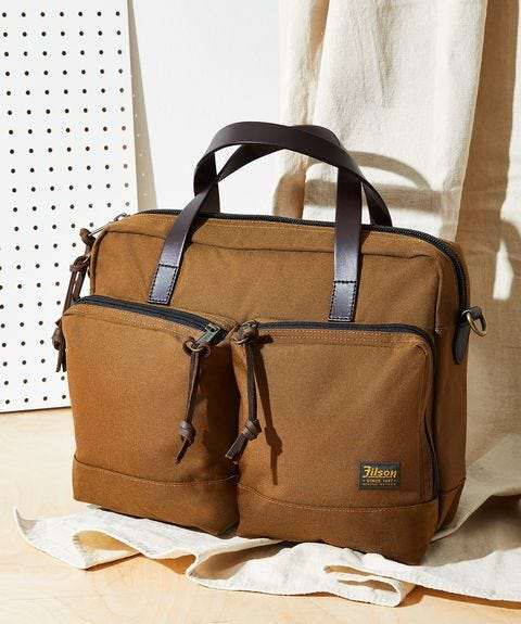 the filson dryden briefcase in the whiskey color sits on a table