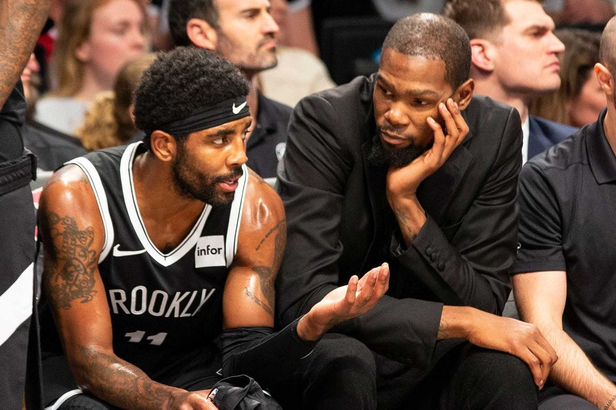 Image result for Kevin durant giving advice on the brooklyn bench