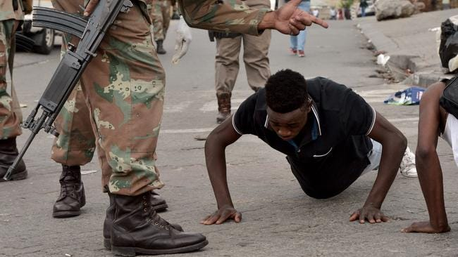 A man is forced to do push-ups by members of the SANDF in Alexandra township in Gauteng at the weekend.  Picture: Oupa Mokoena/African News Agency (ANA)