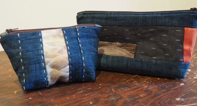 Photograph of two patchwork/boro zip bags.