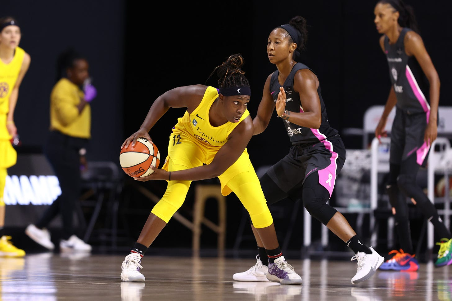 PALMETTO, FL- AUGUST 28: Chelsea Gray #12 of the Los Angeles Sparks handles the ball against the Connecticut Sun on August 28, 2020 at Feld Entertainment Center in Palmetto, Florida.