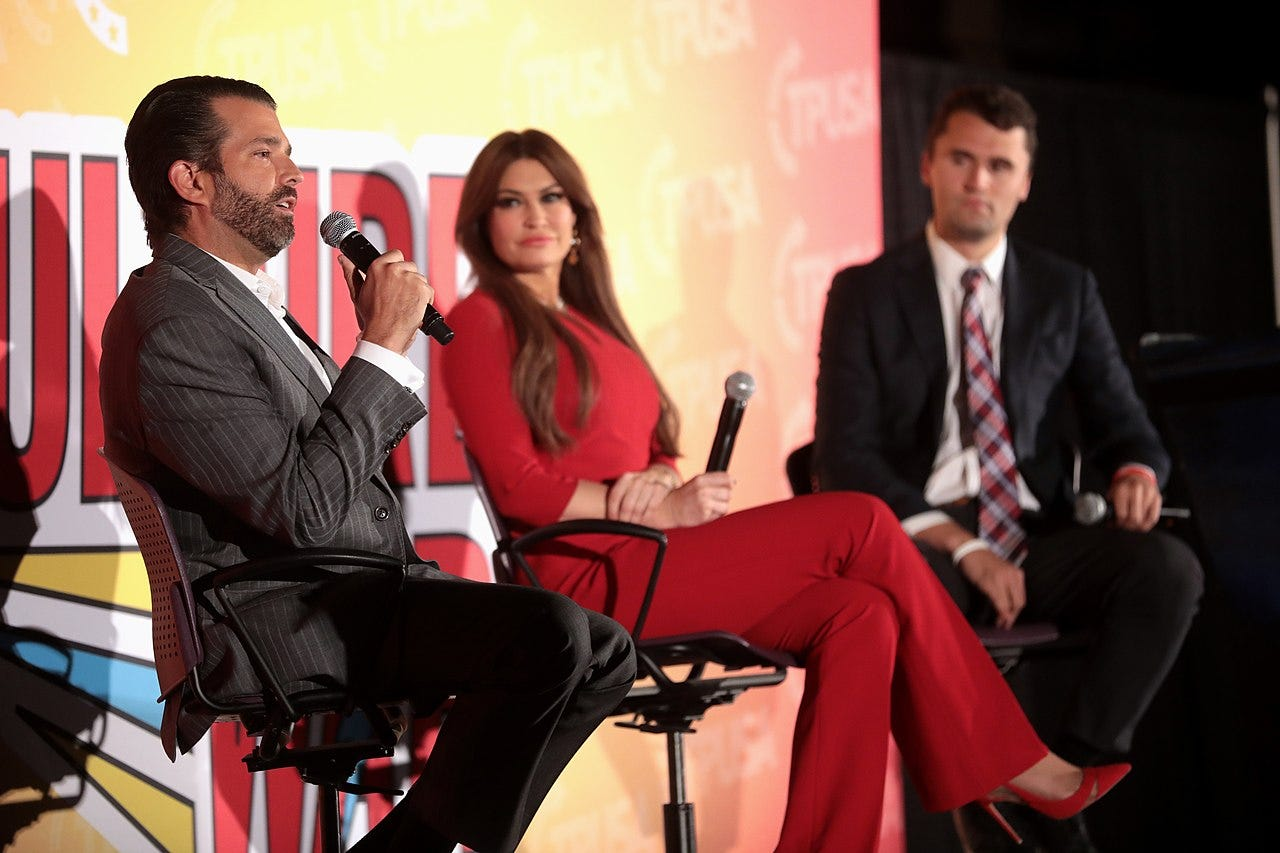 Donald Trump Jr., Kimberly Guilfoyle and Charlie Kirk speaking with attendees at the 2019 Culture War tour in Phoenix, Arizona.