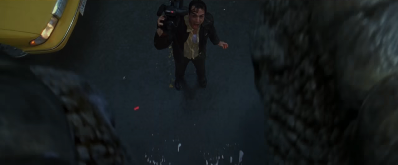Hank Azaria's news cameraman character, screaming in fright as Godzilla's foot comes within inches of his body. From the 1998 film 'Godzilla'