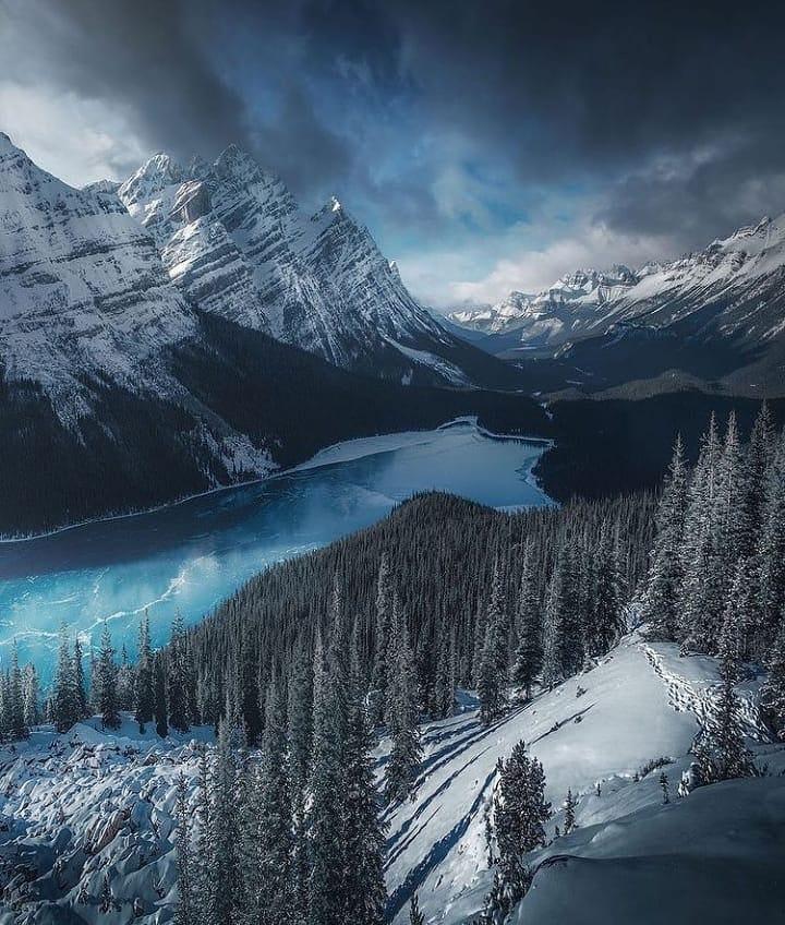 Landscape photo of mountains and lake in winter