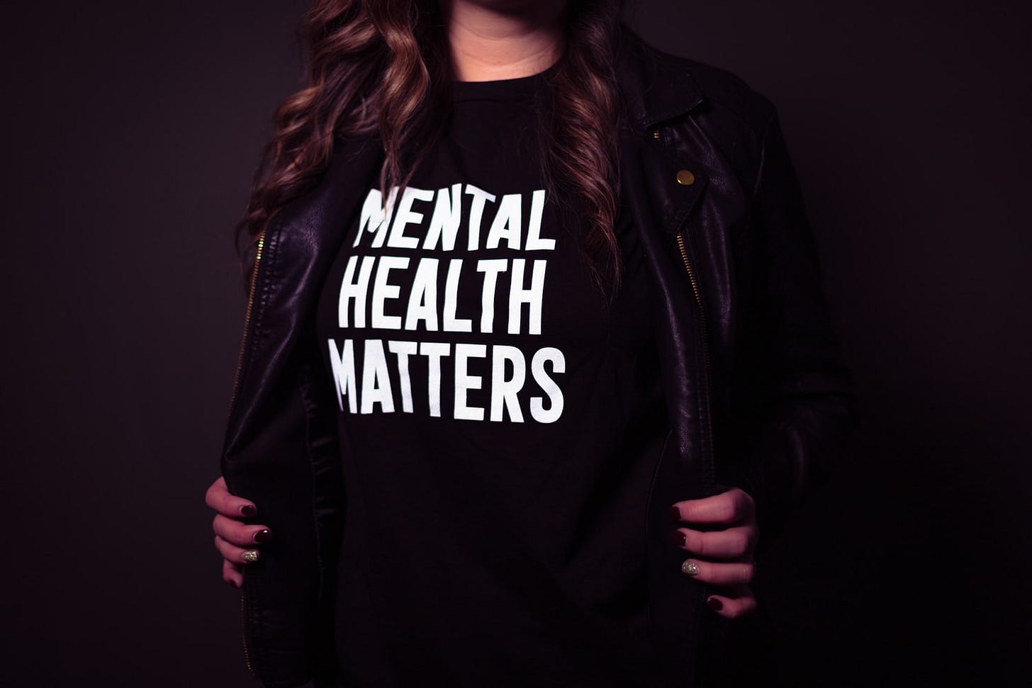 """Person wearing t-shirt that says, """"Mental Health Matters."""""""