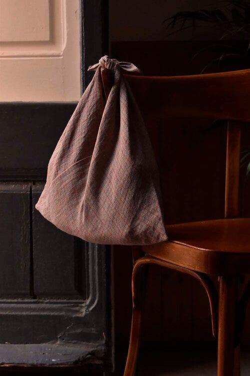 A bag hangs off a chair back