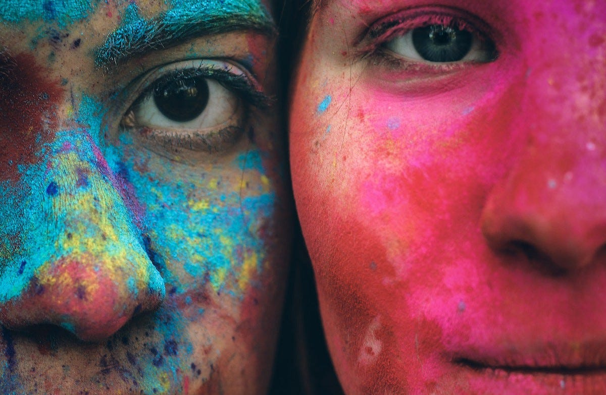 Image of two girls faces painted for article by Larry G. Maguire on creativity