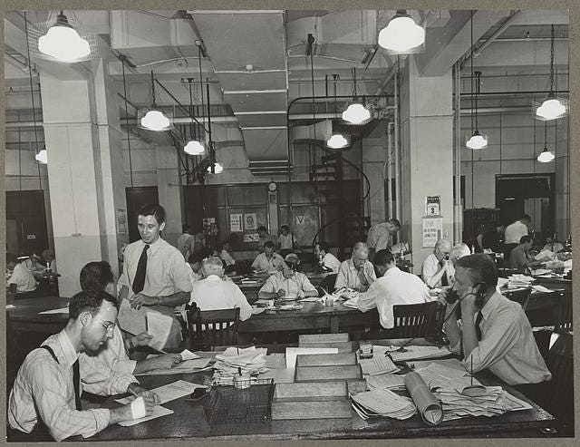News room of the New York Times newspaper Right foreground, city editor. Two assistants, left foreground. City copy desk in middle ground, with foreign desk, to right; telegraph desk to left. Make-up desk in center back with spiral staircase leading to composing room. Copy readers go up there to check proofs.